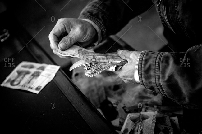 Chinese patient paying in cash for prescription