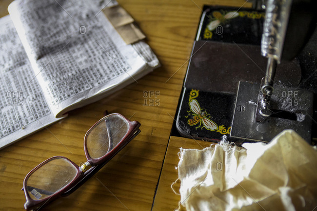 Sewing machine, glasses and Chinese book
