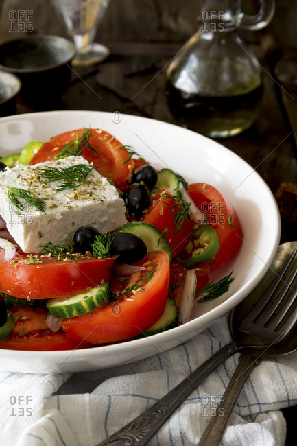 Mediterranean salad topped with dill
