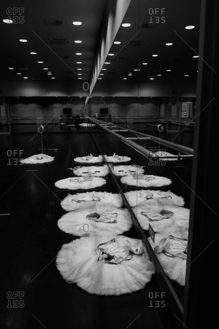 Ballet dancers' costumes lying on floor of studio