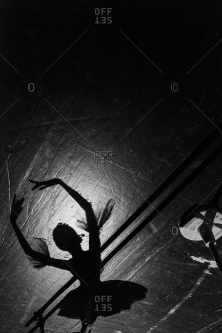 Shadow of a ballerina on the floor of a dance studio