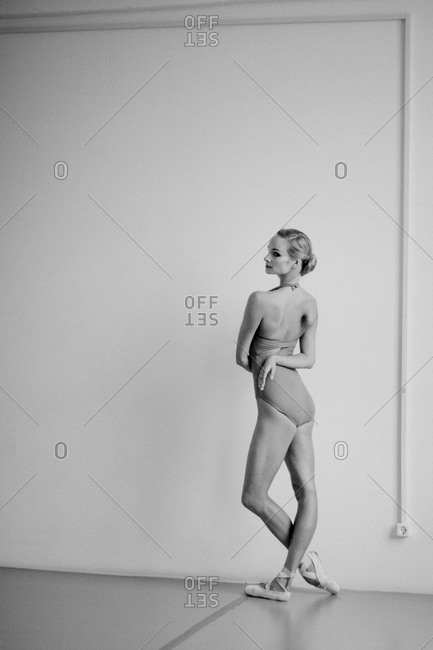 Back view of a dancer against a white wall