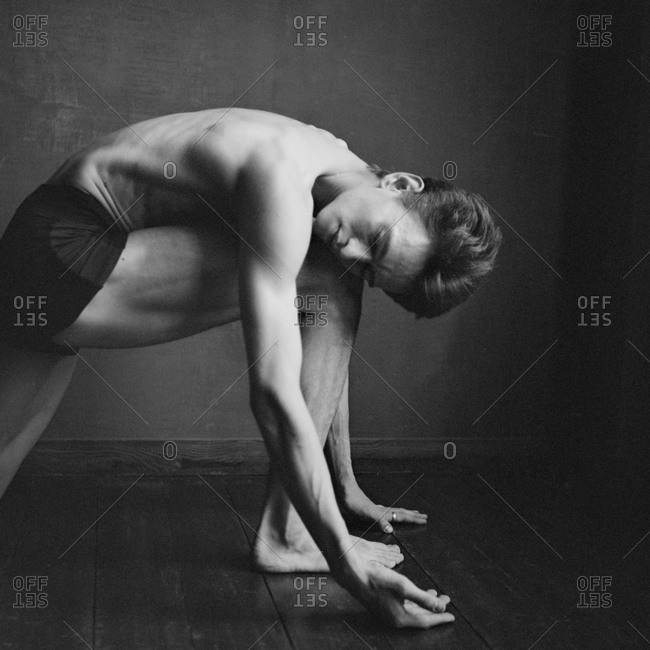 Male dancer folded over in a lunge position