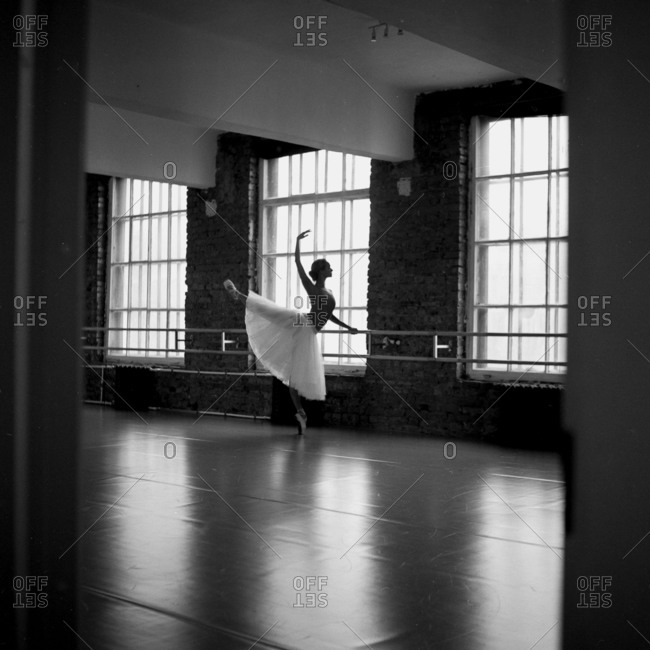 Ballet dancer at a barre in arabesque