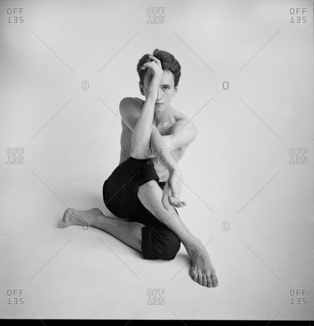 Portrait of a male dancer with legs and arms twisted