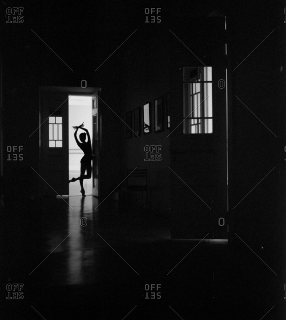 Silhouette of a ballerina in a doorway