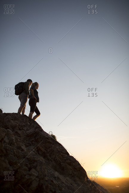 A young couple hike above Salt Lake City