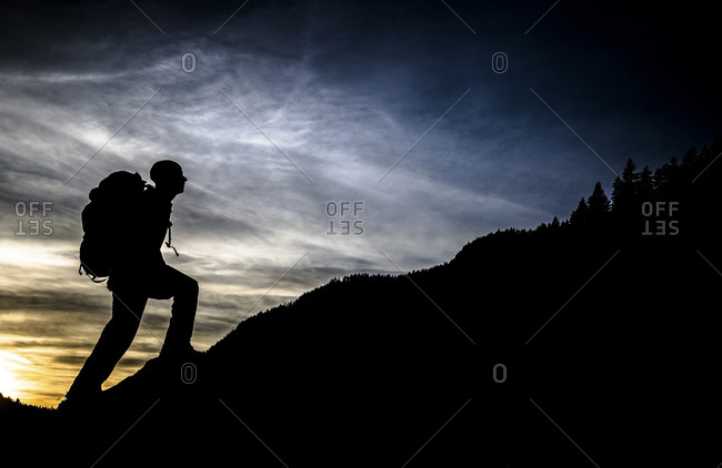 Man hiking at sunset
