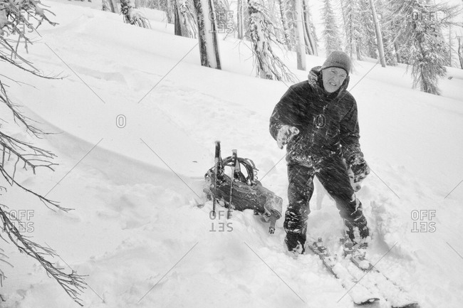 A backcountry skier suffers in blowing wind and cold temperatures during the change over in the Bitterroot Mountains near Victor, Montana