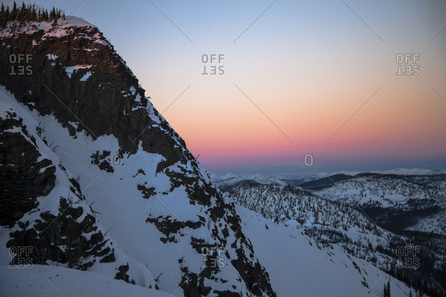 Sunset in Mosquito Peak in the Rattlesnake Wilderness while the Swan Mountain Range as alpenglow in the distance
