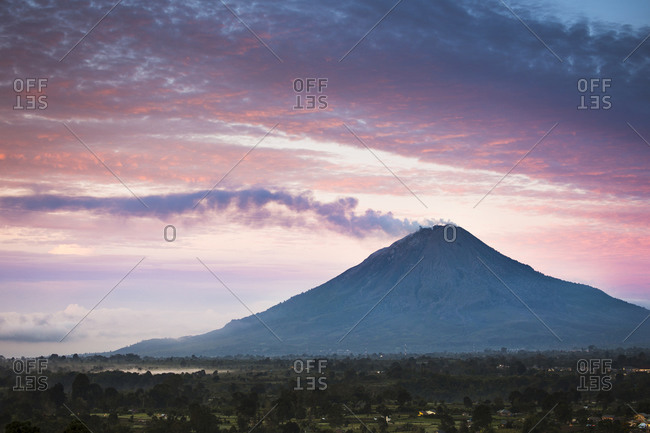Steam coming from Mount Sinabung (Gunung Sinabung) at sunrise