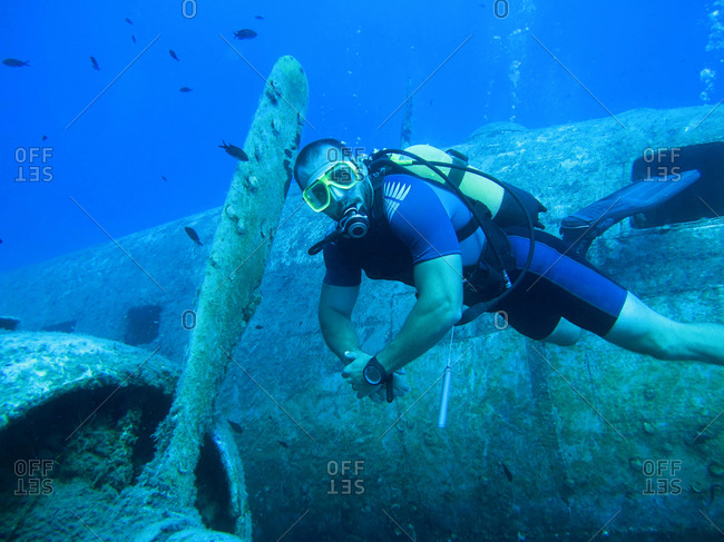 Diver discovering plane wreck