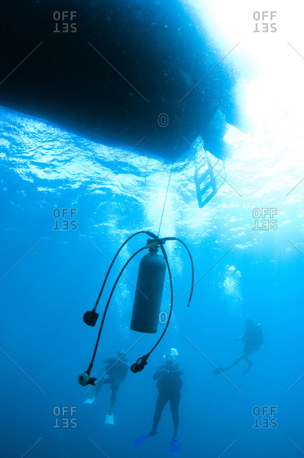 Scuba tank hanging underwater for divers making a safety stop after a deep dive, St Lucia