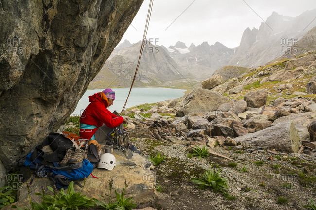 A woman below a rock climb, Titcomb Basin, Wind River Range, Pinedale, Wyoming
