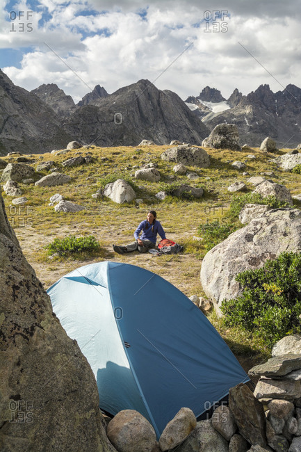 A woman camping in Titcomb Basin, Wind River Range, Pinedale, Wyoming