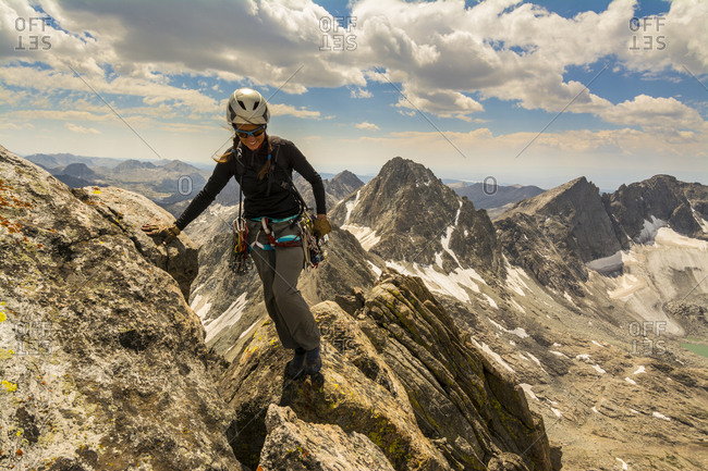 A woman rock climber in Titcomb Basin, Wind River Range, Pinedale, Wyoming