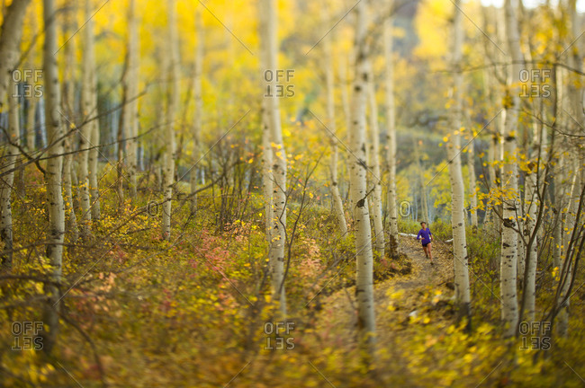 Woman running on a trail in Utah