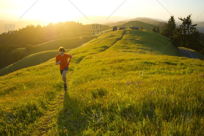 Man runs trails in the Marin Headlands in California