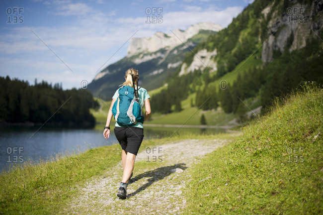 Woman hiking, Appenzellerland, Switzerland