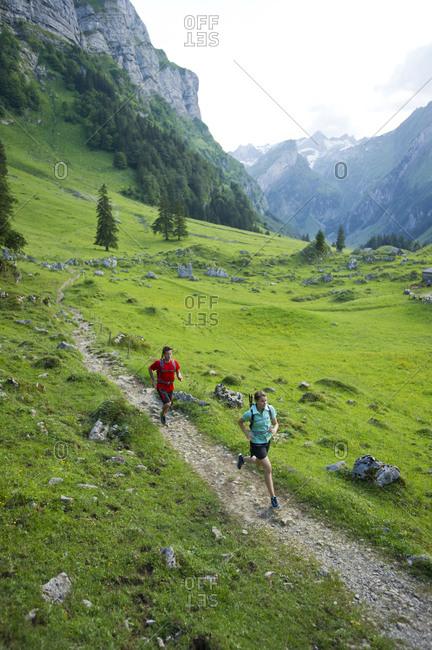 Man and woman hiking, Appenzellerland, Switzerland