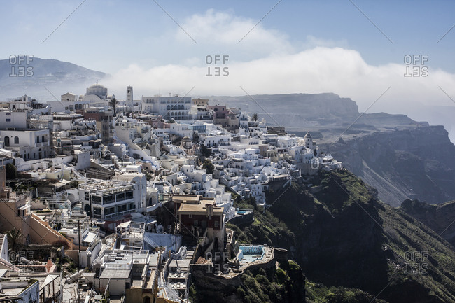 Santorini, Greece, in the early morning with misty clouds