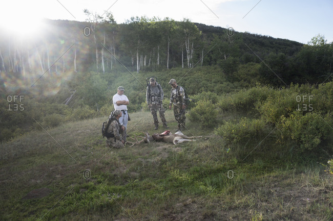 Group of bow hunters with a fresh kill