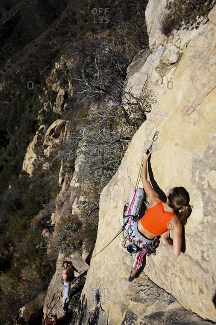 A woman climbing the rapture on Lower Gibraltar Rock in Santa Barbara, California
