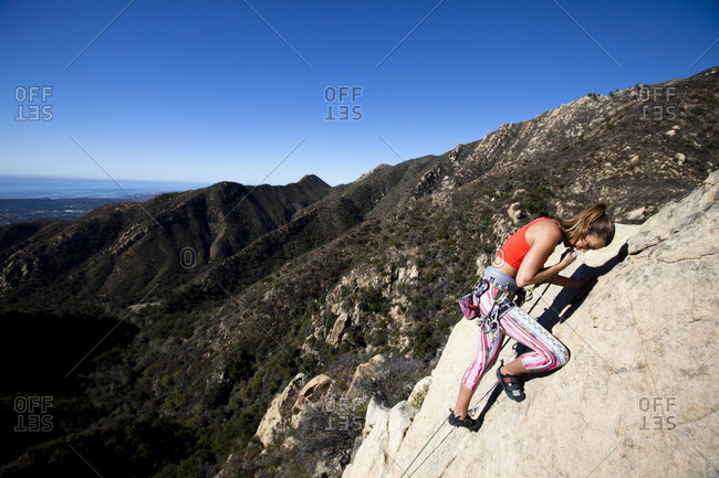A woman climbing the rapture on Lower Gibraltar Rock in Santa Barbara, California