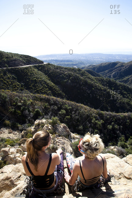 Two female climbers sitting on top of Lower Gibraltar Rock in Santa Barbara, California