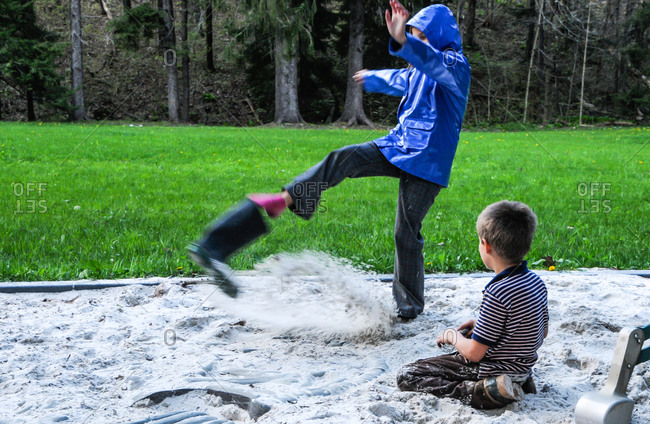 A girl kicks sand out from her boot at Laurel Hill State Park PA