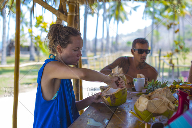 View of a young woman eating coconut