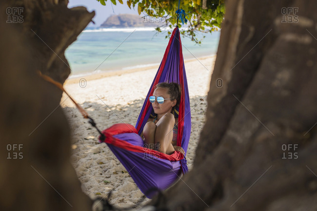 Young woman relaxing in hammock