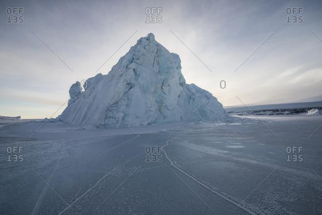An iceberg frozen into the sea ice of the Ross Sea, Antarctica