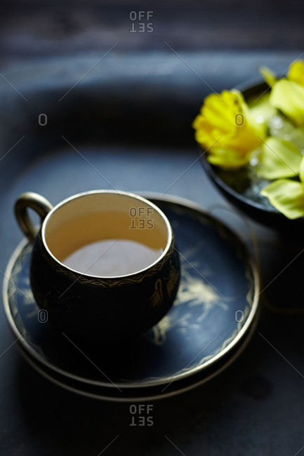 Cup of tea and daffodils