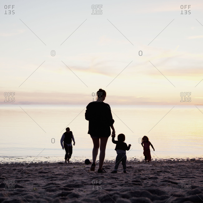 A family at the beach in the evening