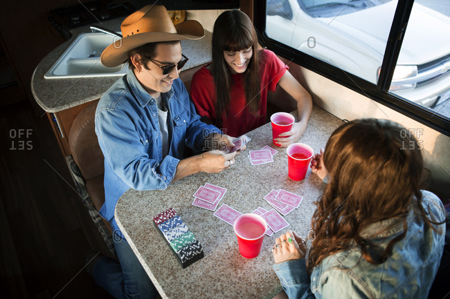 Friends in RV playing card game