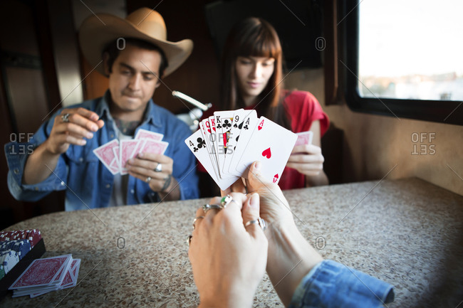 Three friends in RV playing cards