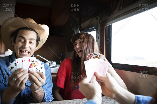 Friends in RV showing card hands