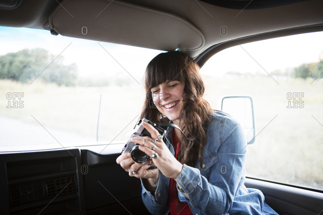 Woman in RV front seat with camera