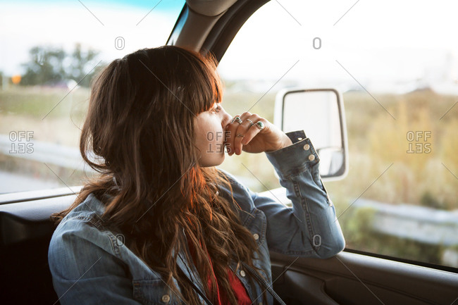 Woman in RV front seat gazing out window