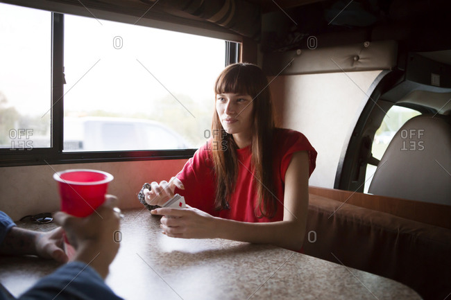 Friends sitting at RV table with cards