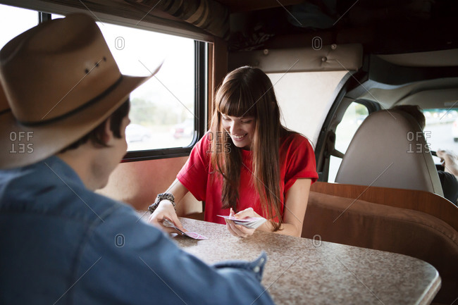 Woman dealing cards at RV table