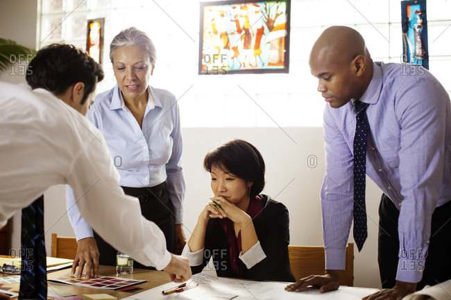 Business people going over designs in conference room