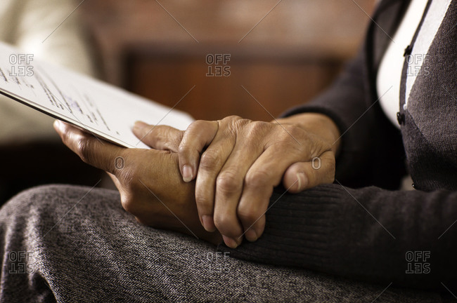 Close up of woman's hands holding report