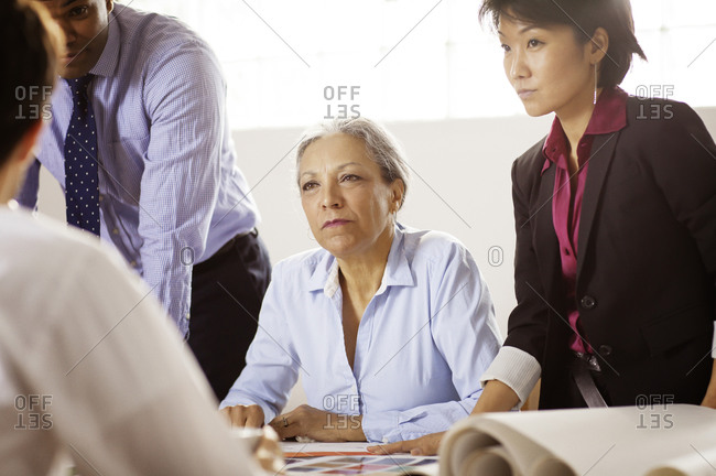 Woman listening in meeting