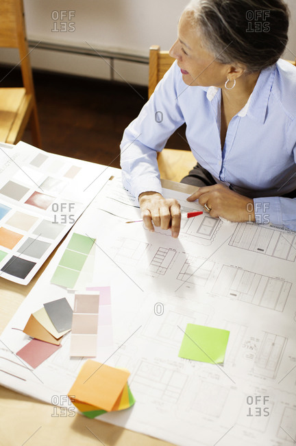 Woman going over designs in conference room