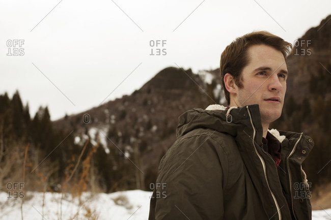 Portrait of man alone in winter mountains