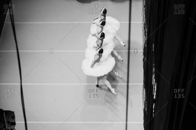 Overhead view of four ballet dancers in perfect formation
