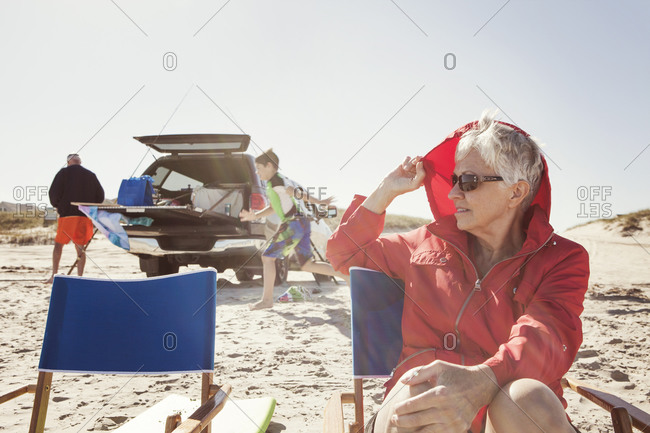 Grandparents and kids unloading car at beach