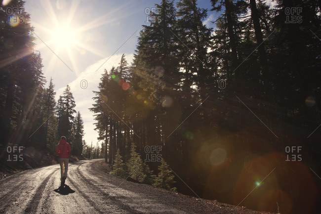 Person walking along isolated mountain road